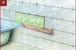 Укладка плитки по уровню ванной.