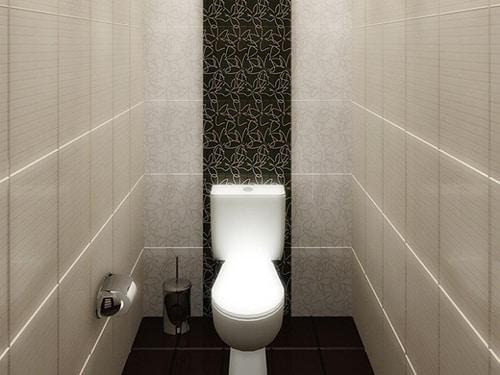 Отделка туалета плиткой.
